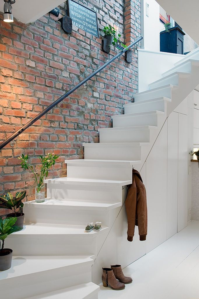 stylish exposed brick wall in the staircase