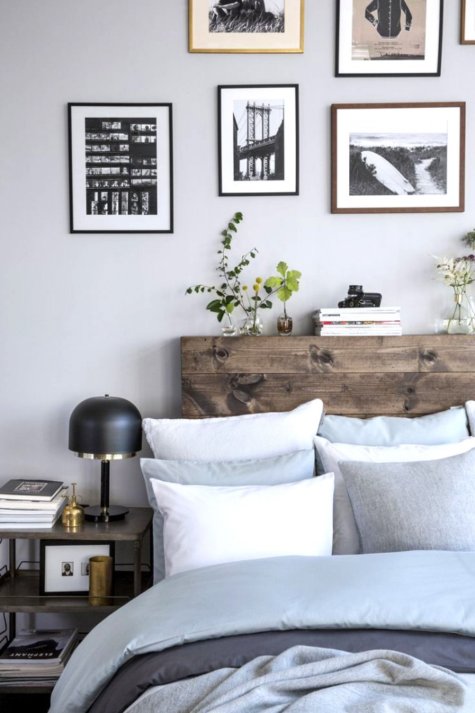 Loft style bedroom with raw wood headboard