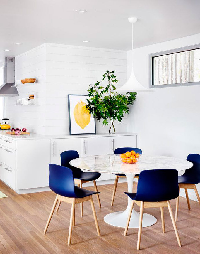 White kitchen with indigo chairs